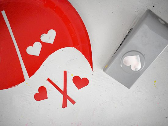 Cut strips and hearts from remainder of red plate for antennae.
