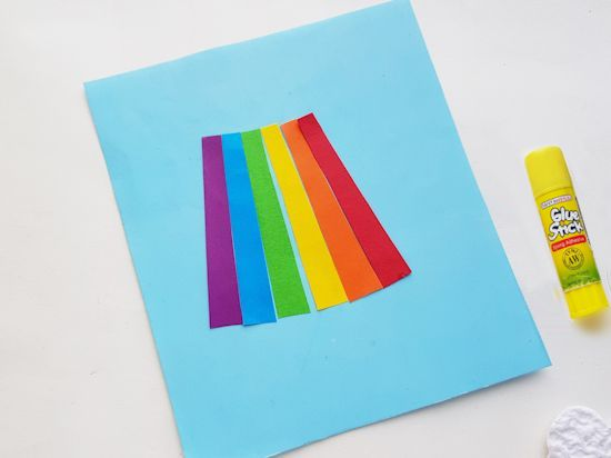 Glue rainbow paper strips.