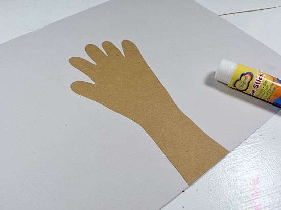 Glue handprint to grey cardstock background.