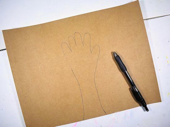 Handprint drawn, past wrist, on brown cardstock.