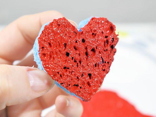 Dip sponge in red paint.