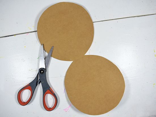 Brown cardstock oval card.