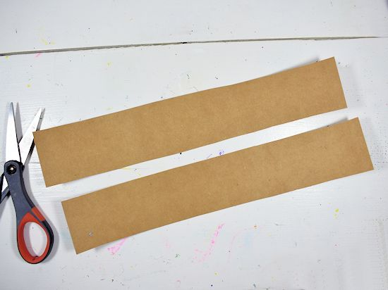 Two brown cardstock strips for arms.