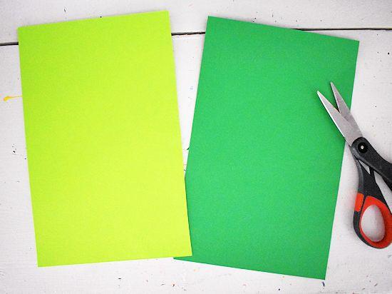 Cut cardstock sheets in half.