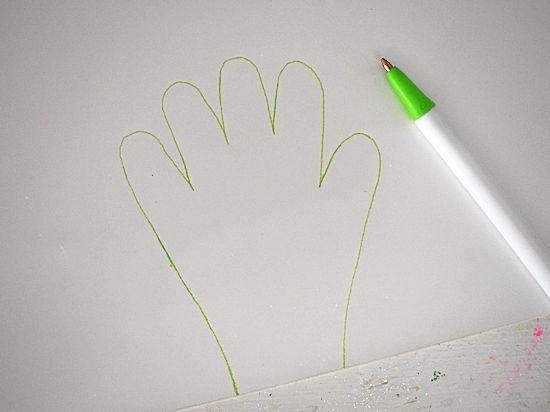 Trace handprint on glitter paper.