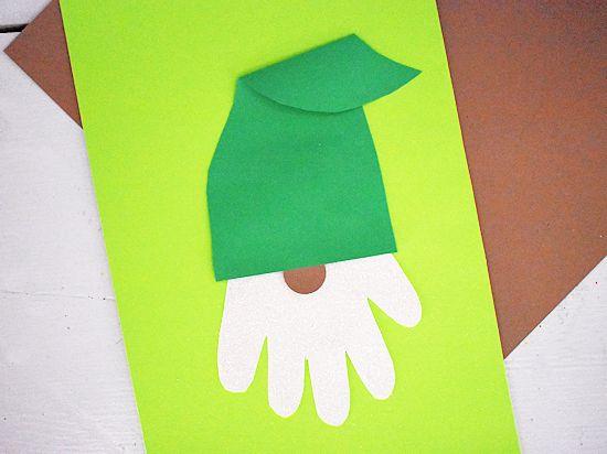 Glue hat over handprint.