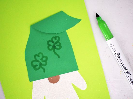 Draw shamrocks on hat with green marker.