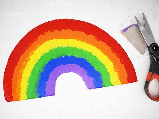 Arch of rainbow cut from cardboard.