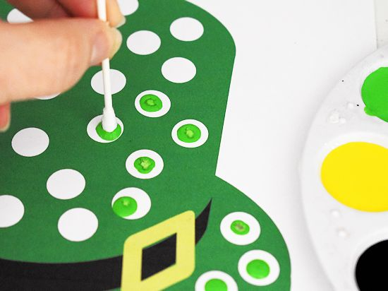 Green qtip dots on leprechaun hat.