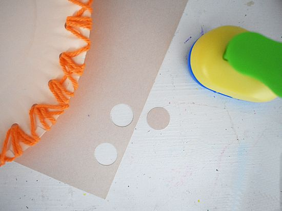 Punch a small circle from skin-toned cardstock.