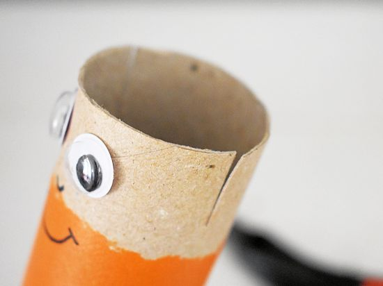 Make small snips in top of cardboard roll.