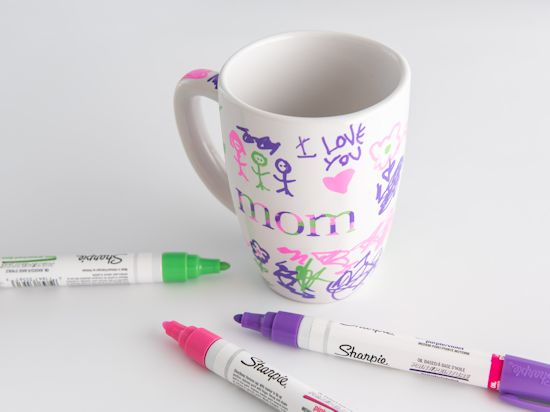 Kid drawings on mug with oil based sharpies.