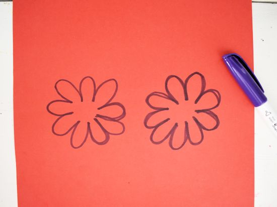 Draw flower shapes on cardstock.