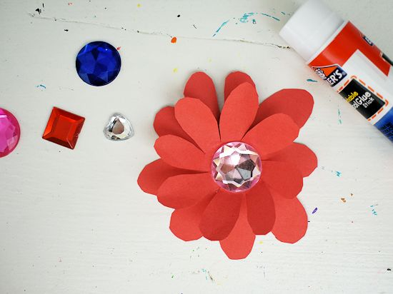 Glue a gem in the center of the flowers.