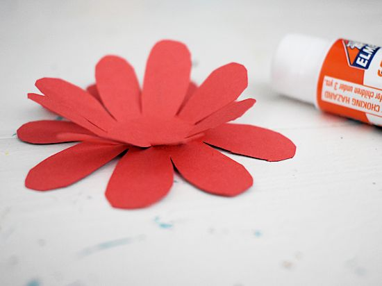 Glue the flower shapes together and fold up edges.