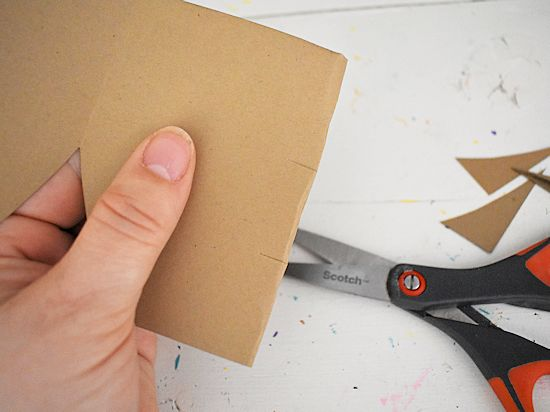 Gently fold and make 2 snips in back of card