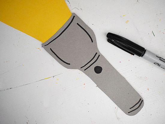 Add detail to flashlight with black sharpie.