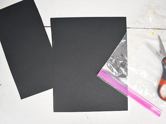 Cut black cardstock to fit a quart size ziploc baggie.