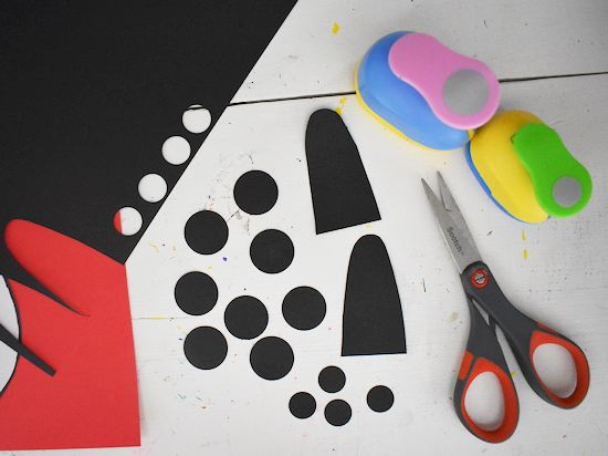 Panda arms, 1 inch, and 5/8 inch circles out of black cardstock.