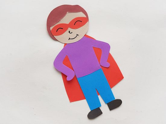 Glue cape to the back of Super Dad use a black pen to draw details on the face.